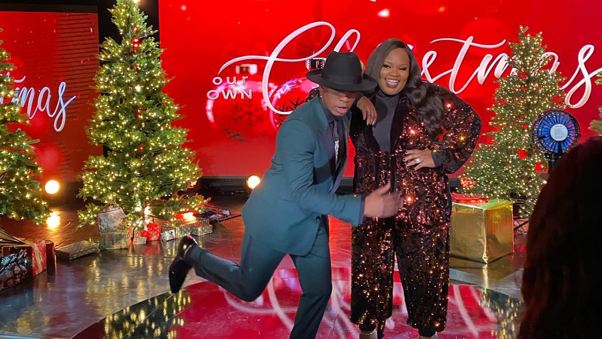 R&B singer/songwriter Ne-Yo and Gospel singer/songwriter Tasha Cobbs-Leonard share a Churchy side hug after their closing performance on Our OWN Christmas.